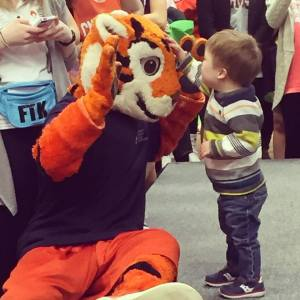 Our miracle child, Brinkley, playing with the tiger at CM 2016!
